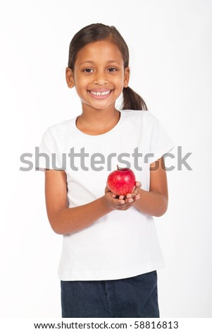 indian girl holding a red apple