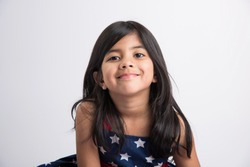 Indian girl posing for photo shoot with joyful and different expressions, isolated over white background