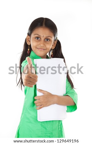 Indian Girl shows thumbs up, white background, focus on face - stock ...