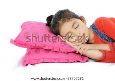 Indian Girl sleeping over pillow.