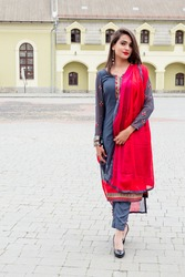 Indian girl walks on a city street. Girl in traditional Indian clothing, salwar kameez