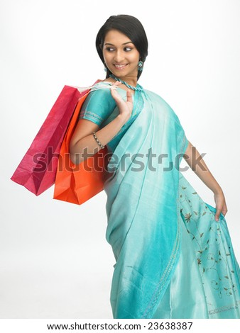 Indian girl with colorful shopping bags