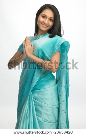 Indian girl with sari in welcome posture