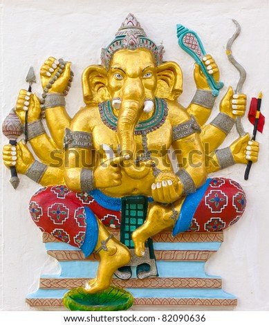Indian God Ganesha or Hindu God Name Duraga Ganapati avatar image in stucco low relief technique with vivid color,Wat Samarn temple,Thailand.