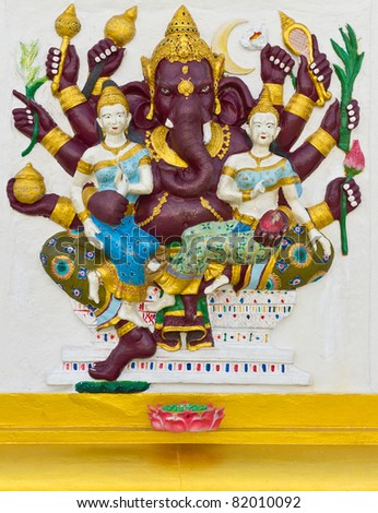Indian God Ganesha or Hindu God Name Maha Ganapati avatar image in stucco low relief technique with vivid color,Wat Samarn temple,Thailand.