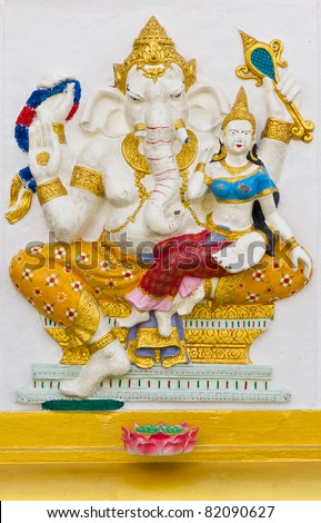 Indian God Ganesha or Hindu God Name Shakti Ganapati avatar image in stucco low relief technique with vivid color,Wat Samarn temple,Thailand.