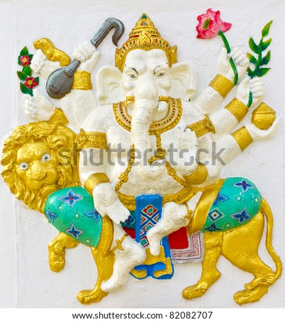 Indian God Ganesha or Hindu God Name Singha Ganapati avatar image in stucco low relief technique with vivid color,Wat Samarn temple,Thailand.