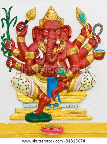 Indian God Ganesha or Hindu God Name Taruna  Ganapati avatar image in stucco low relief technique with vivid color,Wat Samarn temple,Thailand.