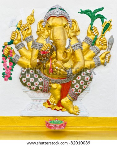 Indian God Ganesha or Hindu God Name Vighna Ganapati avatar image in stucco low relief technique with vivid color,Wat Samarn temple,Thailand.