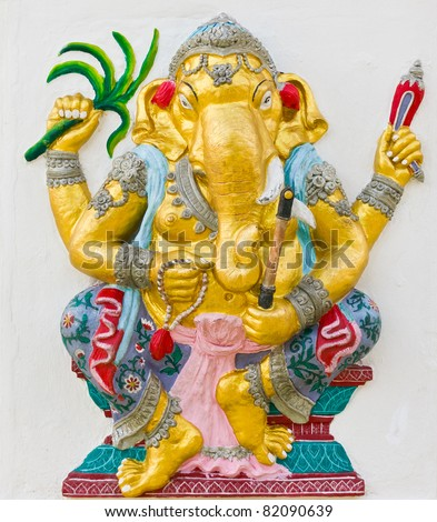 Indian God Ganesha or Hindu God Name Yoga Ganapati avatar image in stucco low relief technique with vivid color,Wat Samarn temple,Thailand.