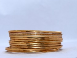 Indian Golden Bangles with white Background. Selective focus on bangles.