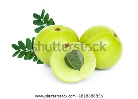 Indian gooseberry fruits or Amla ( phyllanthus emblica ) with green leaves and slice isolated on white background. macro