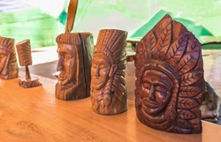 Indian heads statue on wooden table.