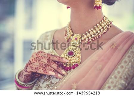 Indian hindu bride is wearing her jewellery #1439634218