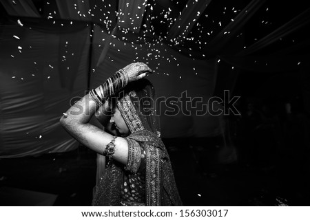 Indian Hindu wedding Bride Bidding good bye to the parents after her wedding She throws rice behind her to wards her parents This ritual is called VIDAI in the local language Hindi