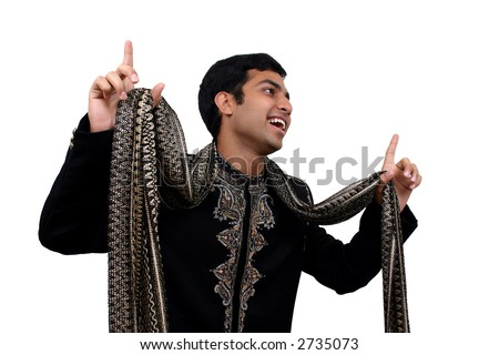 Indian in traditional clothes in dancing pose with clipping path
