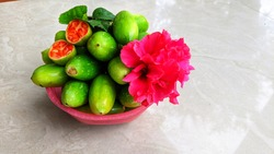 Indian Ivy gourd or Coccina Grandis vegetables in a pink bowl. scarlet gourd, tindora, and kowai fruit, is a tropical vine of family Cucurbitaceae. mostly found in India.