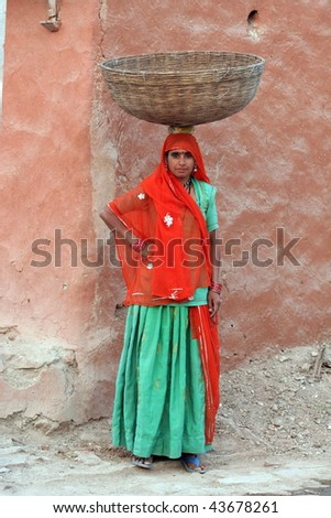 stock-photo-indian-lady-carrying-basket-from-rajasthan-43678261.jpg