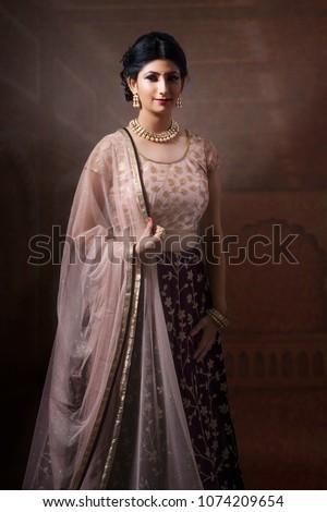 Indian Lady in Ethnic wear #1074209654