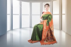 Indian lady in saree sitting on chair