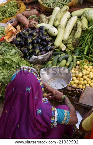 Indian lady selling fruit and veg at a street market in Pushkar, Rajasthan, India
