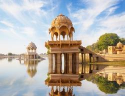 Indian landmarks - Gadi Sagar temple on Gadisar lake -  Jaisalmer, Rajasthan, north India