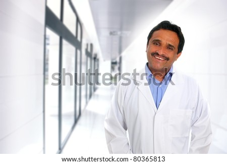 Indian latin expertise doctor smiling in the hospital corridor [Photo Illustration]