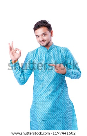 Indian man in ethnic wear , showing gesture with hand , isolated over white background #1199441602