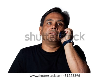 Indian man on hold, talking on a cell phone. Isolated image - stock photo