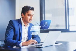Indian man receiving alert notification in financial fraud protection software on his computer