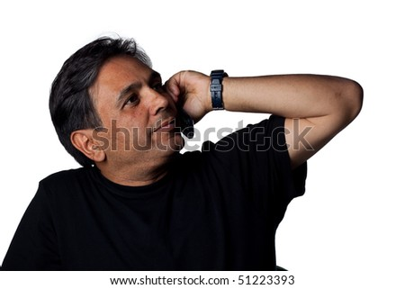 Indian man talking on the phone, isolated image