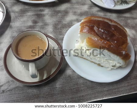 Indian Masala Chai with Bun Maska Bread