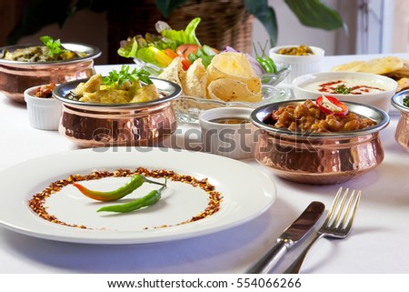 Indian meal on setting on table