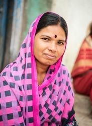 Indian mid-age lady closeup with traditional saree in rural village Salunkwadi, Ambajogai, Maharashtra, India, Southeast, Asia