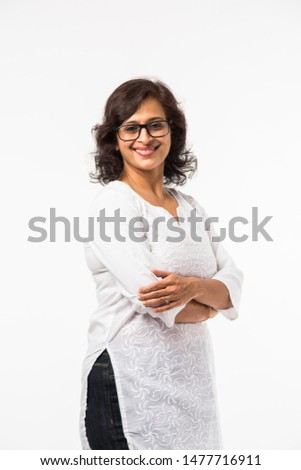 Indian Mid age women/lady's portrait, standing isolated over white background