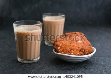 Indian milk tea or Chai  with Parippu vada Kerala Snacks popular deep fried hot and spicy tea time food. Traditional food for Ramadan, Eid, Iftar pary, Onam, Vishu. Local street food of India.