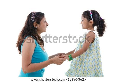 indian mother and daugther staring at each other