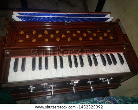 indian musical instrument harmonium instrument #1452525392
