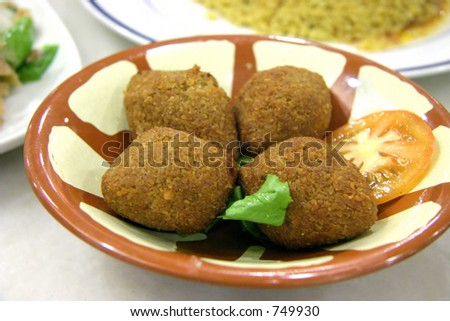 Indian muslim dish: four falafels in a bowl with a sprig of parsley