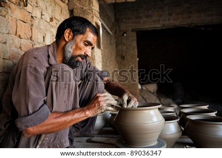 Indian muslim potter making a terracotta vase