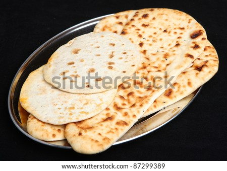Indian naan and roti flatbreads - stock photo