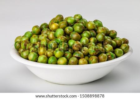 Indian Namkeen Snack Food Masala Green Peas Also Know as Spicy Green Peas, Masala Matar, Hara Matar, Masala Vatana, Spiced Fried Green Peas or Chatpata Matar Serve in Bowl Foto stock ©