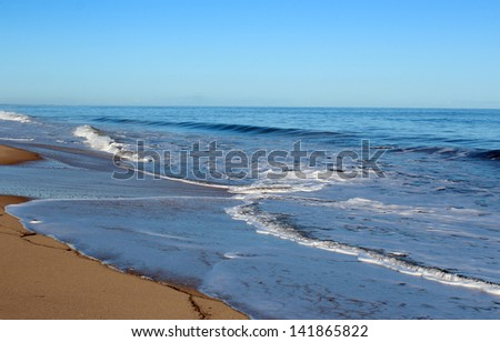 Indian Ocean waves rolling in at Mangles beach Bunbury Western Australia on a calm early morning in winter.