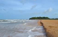 Indian ocean with golden sand, Bentota, Sri Lanka. A wonderful nature landscape of a beach scene.