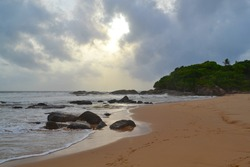 Indian ocean with golden sand, Bentota, Sri Lanka. A wonderful nature landscape of a beach scene.