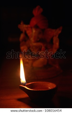 Indian Oil Lamp with Lord Ganesha - stock photo