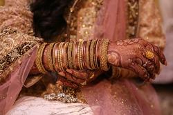 Indian Pakistani Desi Bride hands, holding her bangles