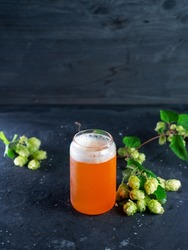 Indian pale ale, a glass of craft beer and green hops