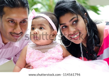 Indian parents and baby girl at outdoor home garden