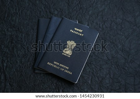 Indian Passport and currency note for making foreign travel or world tour budget plan.